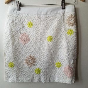 NWOT White Lace Skirt with Stitched on Flowers